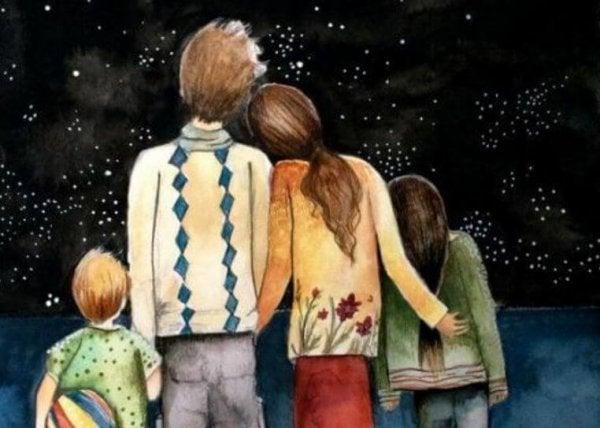 yıldızlara bakan sarılan aile