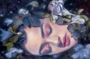 çiçeklerle uyuyan kadın