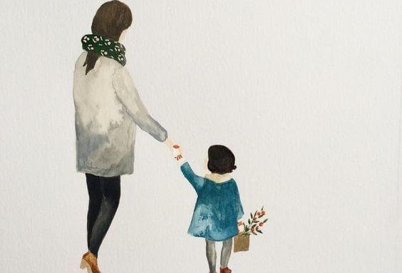 kadın ve çocuk el ele yürüyorlar