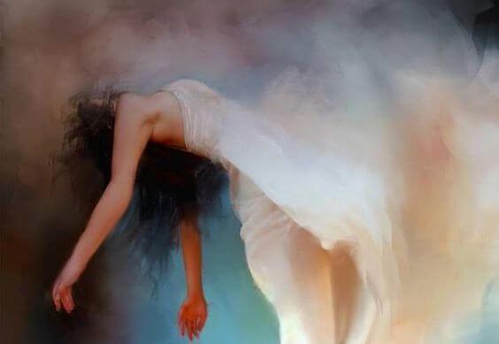 beyaz kıyafeti ile havada süzülen kadın