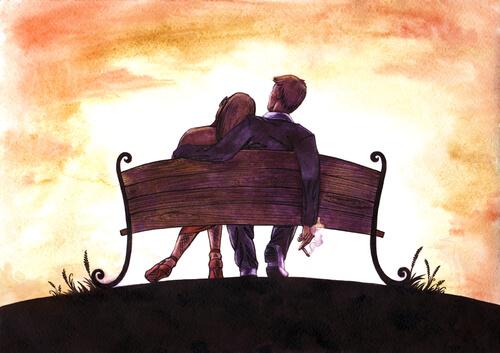 başını sevgilisin omzuna yaslamış kadın ve sevgilisi bankta oturuyor
