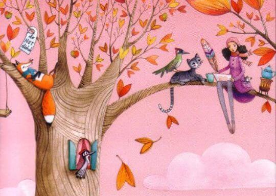 sonbaharda ağaçta hayvanlar ile oturan kadın