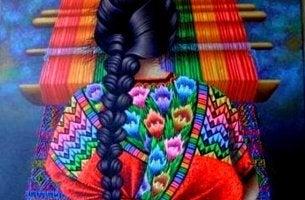 renkli bir halı ören kadın