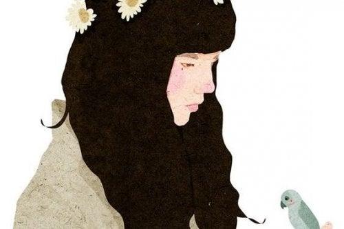 saçlarında çiçekli kız ve kuş