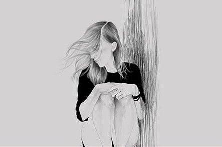 oturan mutsuz kız