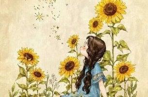 küçük kız ve ayçiçekleri