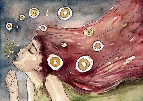 çiçeğe üfleyen kız