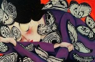 kelebekler ile uyuyan kadın
