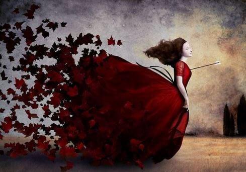 kırmızı elbiseli kadın sonbahara karışıyor