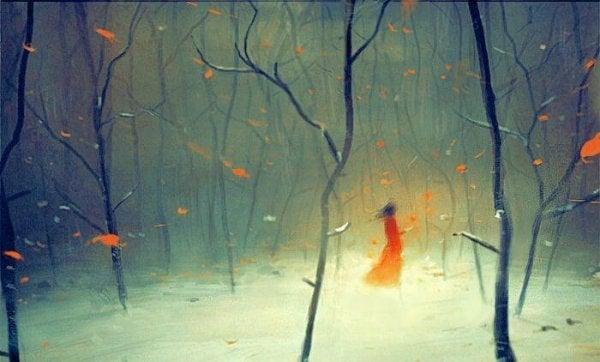karda kırmızı elbiseli kız