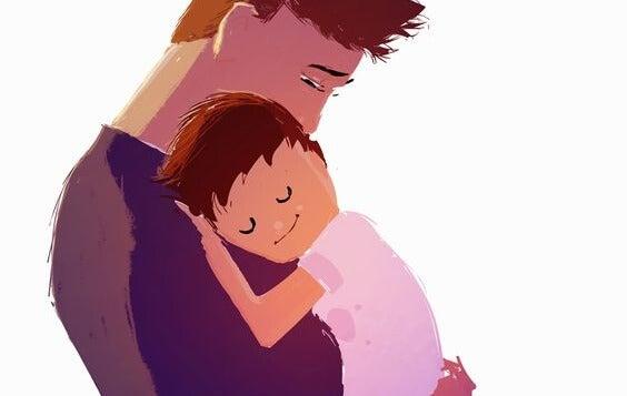 oğlunu kucaklayan baba
