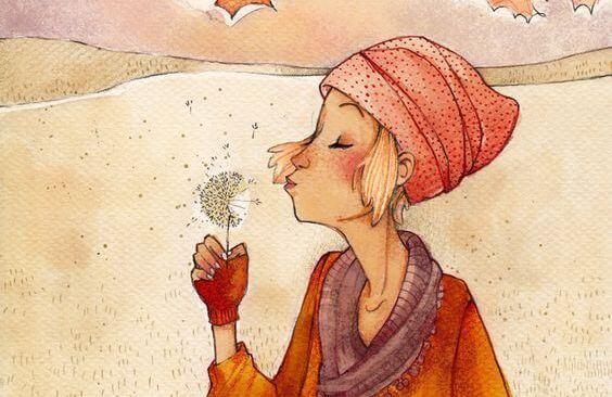 çiçeğiüfleyip dağıtan kadın