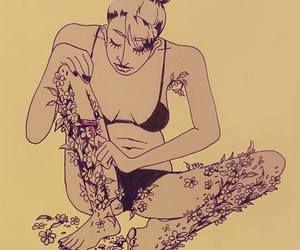 bacağındaki çiçekleri tıraşlayan kız