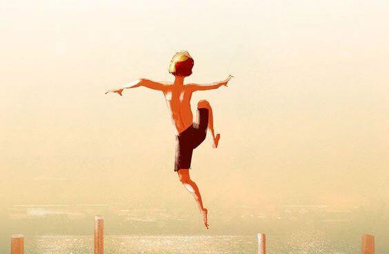 erkek çocuğu denize atlıyor
