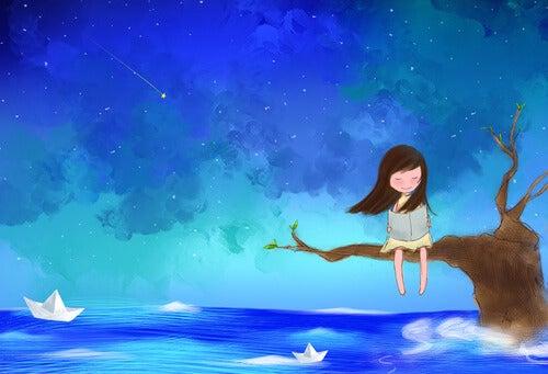 denizde dalda oturan kız ve kağıt kayıklar