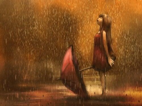 yağmurda şemsiyeli kız