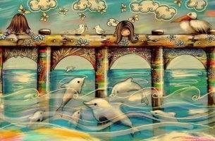 köprünün üstünden yunusları izleyen kız