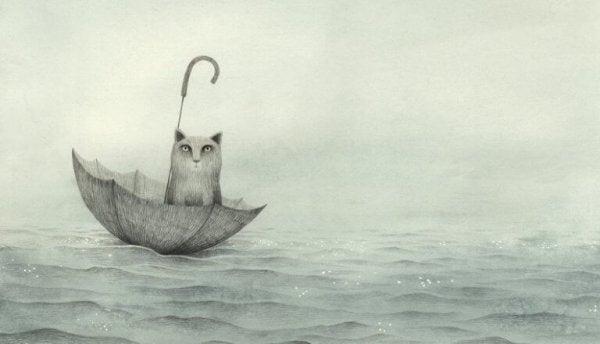 denizde şemsiyeye oturan kedi