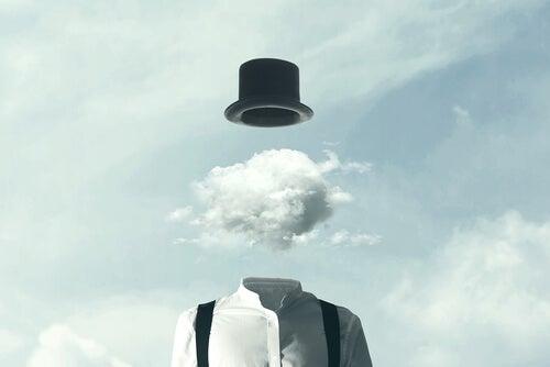 adamın kafası bulut olmuş şapkası uçmuş
