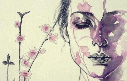 yüzünde çiçekler olan kadın
