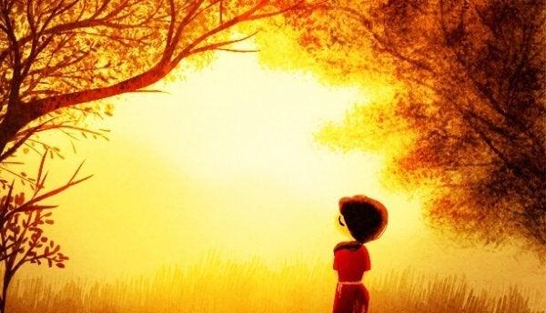 güneş ve ağaçlar altında kırmızılı insan çizimi