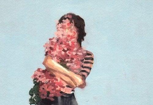 kendine sarılan çiçek insan