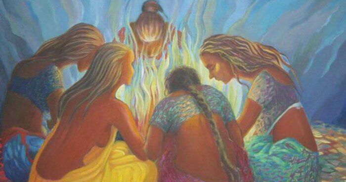 kadınlar ateşin başında oturuyor