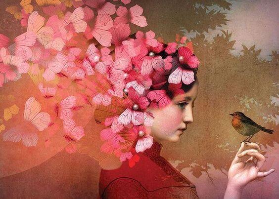 pembe kelebekli elinde kuş tutan kız