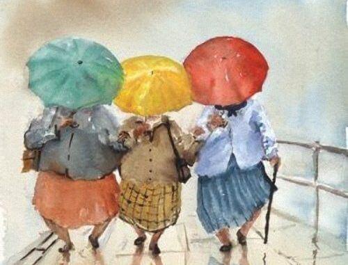 renkli şemsiyeler altında yürüyen kadınlar