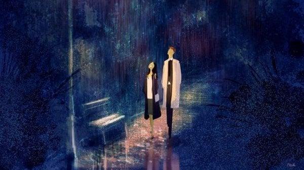 yağmurda yukarı bakan çift