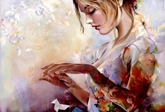 elinde kağıt kuş olan kız