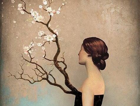 kadın ve çiçekli dal