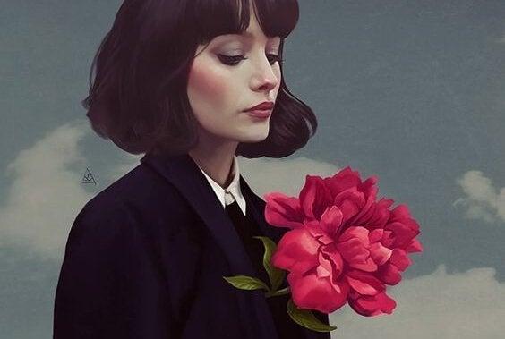 kadın ve kırmızı çiçek