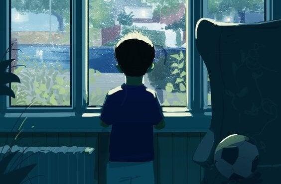 pencereden dışarıya bakan çocuk