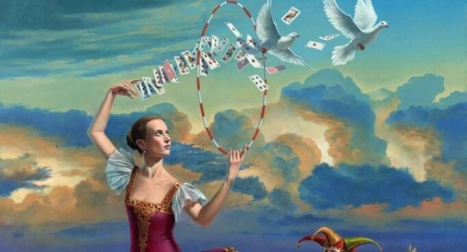 sihirbaz kız, oyun kartları ve beyaz kuşlar