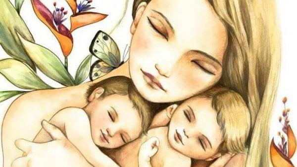 bebeklere sarılan anne