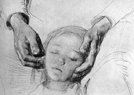 çocuğun kafasını tutan eller