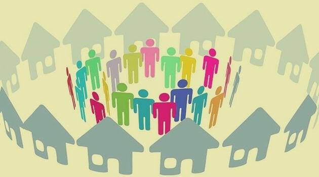aynı yerde yaşayan etrafında evler olan insan figürü topluluğu