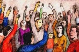 bir elleri havada olan insan topluluğu