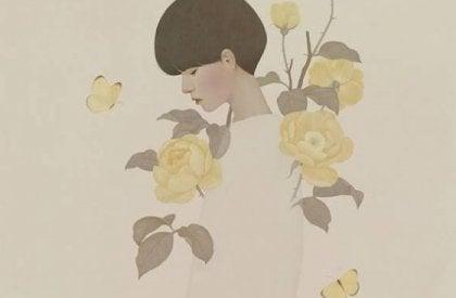 kadın ve beyaz çiçekler