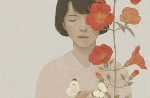 kadın ve kırmızı çiçekler