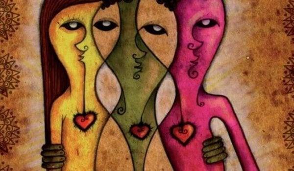üç kadın figürü birbirine sarılıyor