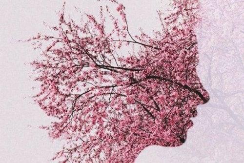 alzheimer hastaları sembolü olan pembe yapraklı insan görünümlü ağaç