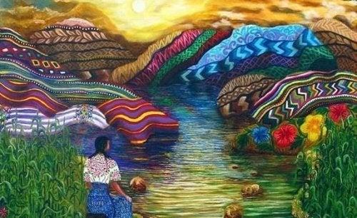 renkli dağlarda oturan kadın