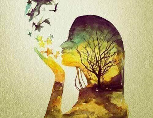 yıldızlara üfleyen kadın silüeti ve ağaç