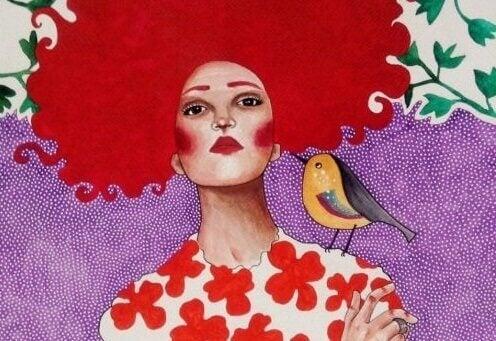 Kırmızı saçlı ve kuşlu kadın