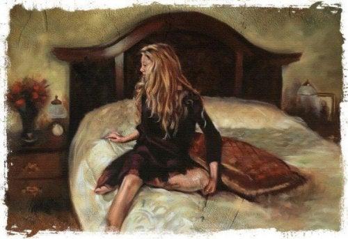yatakta oturan kadın