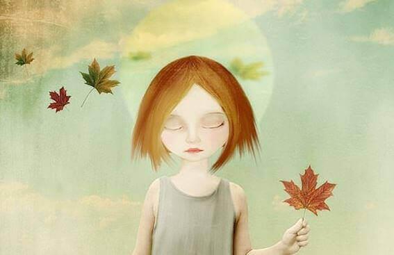 kurumuş yaprak tutan çocuk