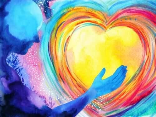 sarı kalbi elinde tutan insan figürü