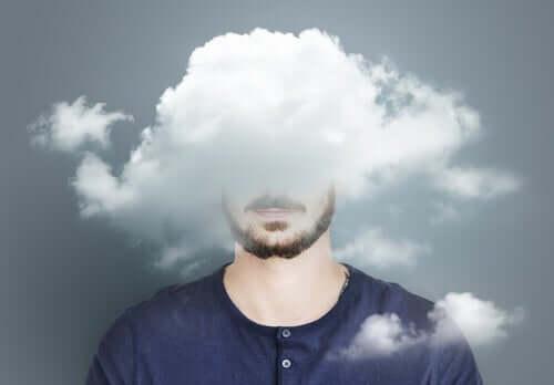 Kafasının üzerinde bulutlar olan bir adam illüstrasyonu.